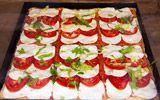 """Tray of pizza """"al taglio"""" with fresh tomatoes and mozzarella"""